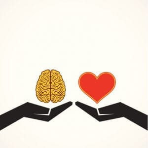 Two hands, one holding a brain and the other holding a heart